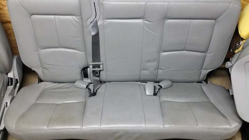 the leather itself in back seat has some lines on it too  it looks like a  car seat was left there permanently